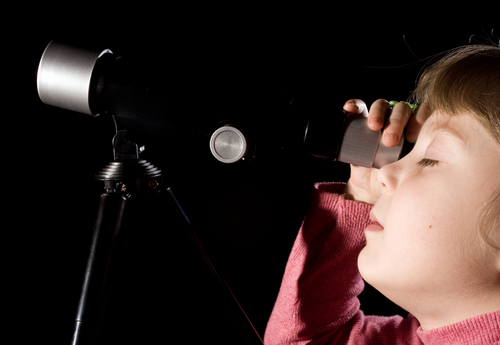 Discovery - a child using a telescope